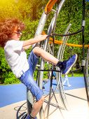 Boy Playing Playground Equipment. Active Little Child Playing On Climbing Net At School Yard Playgro poster