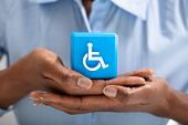 Human Protecting Cubic Block With Disabled Handicap Icon poster