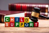 Child Support Colorful Block With Bible And Hammer Over Wooden Desk In Courtroom poster