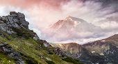 Magical Mountains Landscape. Majestic Sunset. Overkast Sky Over Rock Peak Under Sunlit. Awesome Alpi poster