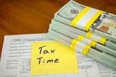 Tax Deductions And Individual Tax Return Form On Table.  How To Lodge Your Tax Return. poster