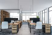 White Open Space Office With Wooden Tables poster