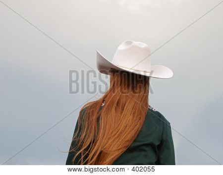 Cowgirl With Red Hair And White Hat