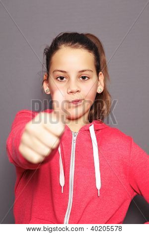 Dubious Young Girl Giving A Thumbs Up