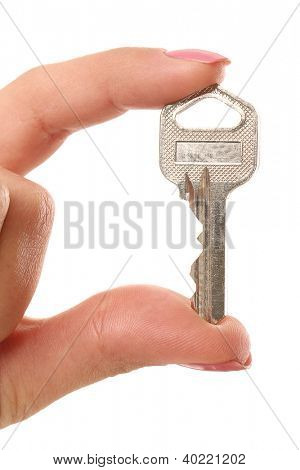 Close up of woman hand holding a key over a white background