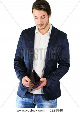 Unhappy, Worried Guy Looking At Empty Wallet
