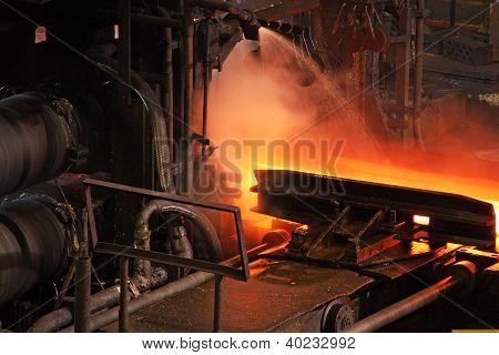 Rolling hot steel.