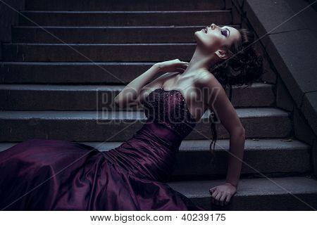 Beautiful woman in violet dress