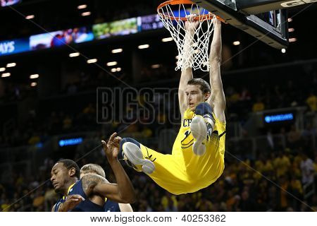 BROOKLYN-DEC 15: Michigan Wolverines guard Nik Stauskas (11) dunks against the West Virginia Mountaineers during the first half at Barclays Center on December 15, 2012 in Brooklyn.