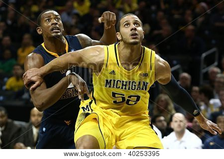 BROOKLYN-DEC 15: Michigan Wolverines forward Jordan Morgan (52) and West Virginia Mountaineers forward Dominique Rutledge (1) wait for a rebound at Barclays Center on December 15, 2012 in Brooklyn.