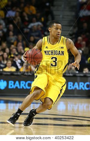 BROOKLYN-DEC 15: Michigan Wolverines guard Trey Burke (3) dribbles the ball against the West Virginia Mountaineers  during the first half at Barclays Center on December 15, 2012 in Brooklyn.