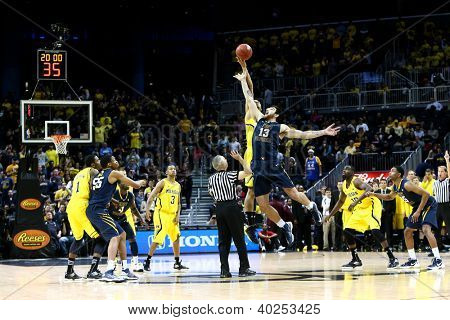 BROOKLYN-DEC 15: West Virginia Mountaineers forward Deniz Kilicli (13) goes up for the ball against the Michigan Wolverines during the first half at Barclays Center on December 15, 2012 in Brooklyn.