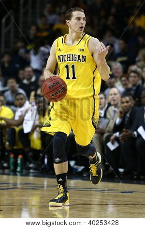 BROOKLYN-DEC 15: Michigan Wolverines guard Nik Stauskas (11) dribbles the ball against the West Virginia Mountaineers during the first half at Barclays Center on December 15, 2012 in Brooklyn.
