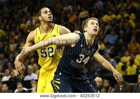 BROOKLYN-DEC 15: Michigan Wolverines forward Jordan Morgan (52) and West Virginia Mountaineers forward Kevin Noreen (34) wait for a rebound at Barclays Center on December 15, 2012 in Brooklyn.