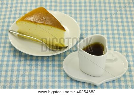 Cheese Cake And Coffee On The Table