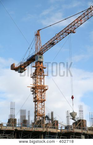 A Construction Site With A Yellow Crane