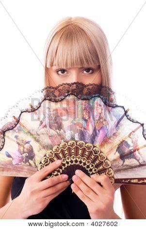 Beautiful Blond Woman With A Fan