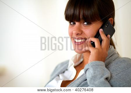 Young Female Looking At You Speaking On Cellphone