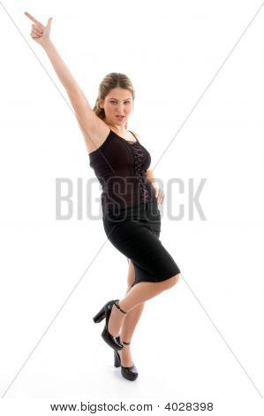 Beautiful Young Woman Pointing Upwards