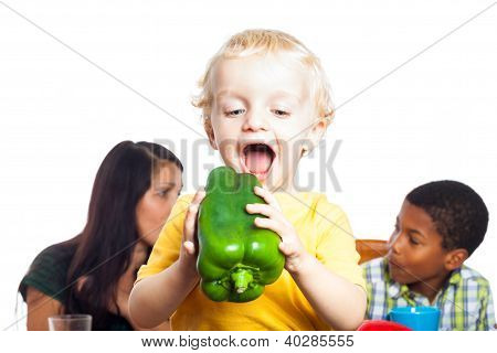 Funny Child Eating Vegetable