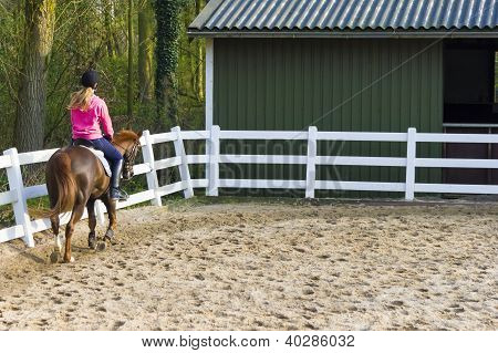 Young Girl Riding A Running Horse