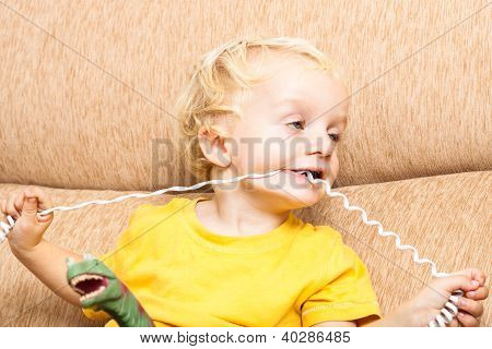Funny Child Biting Phone Wire