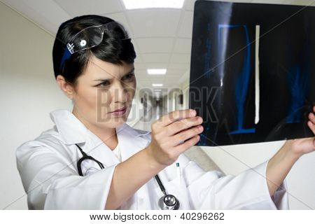 Female doctor looking at an x-ray in a hospital