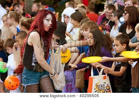 Woman Hands Out Candy At Halloween Parade