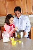 Girl And Mother Cooking poster