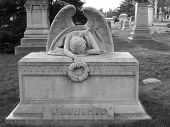 stock photo of burial-vault  - Angel on top of gravestone in the Greenwood Cemetery in Brooklyn  - JPG