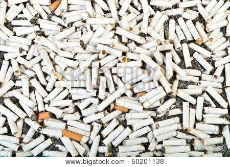 Two hungred  dirty cigarette butts background