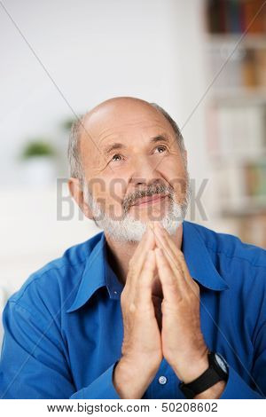 Worried Religious Senior Man Praying