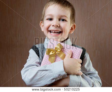 Cute Little Boy Holding Dotted Present Boy