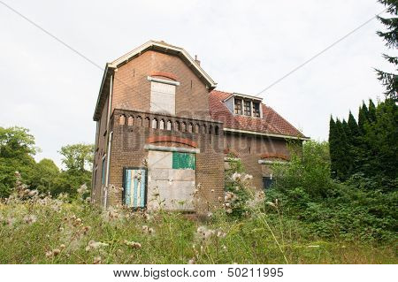 inhabitable old house with boarded windows