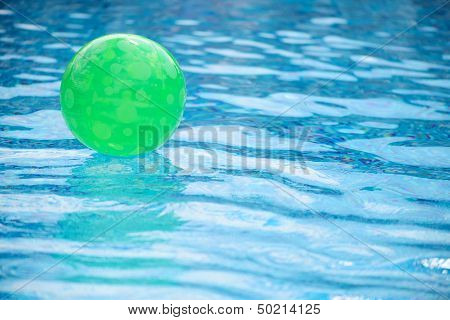 Green Ball Floating In Swimming Pool