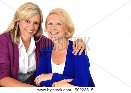 Two women hugging, studio isolated on white.