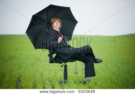 Handsome Businessman With Umbrella