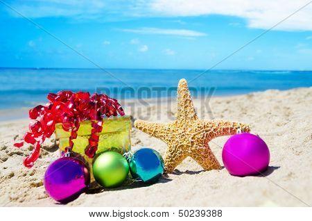 Starfish With Gift Box And Christmas Balls On The Beach