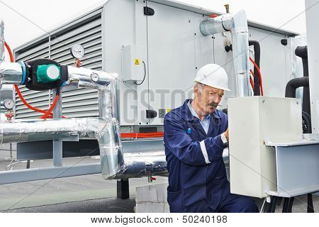 senior adult ventilation electrician builder engineer at work