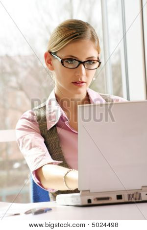 Business Woman Is Working With A Laptop