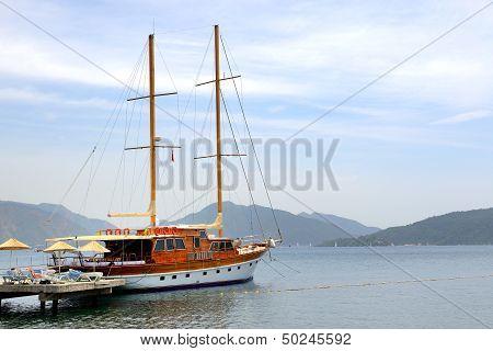 Sail Yacht Near Beach On Turkish Resort, Marmaris, Turkey