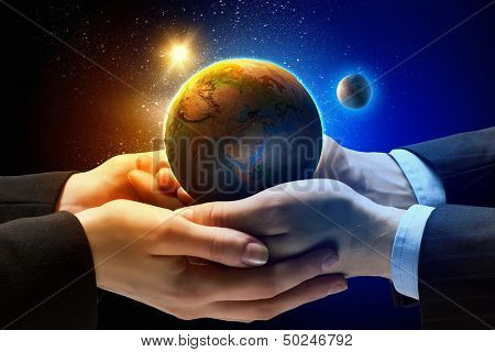 Close up image of human hands holding earth planer. Ecology conceptElements of this image are furnished by NASA