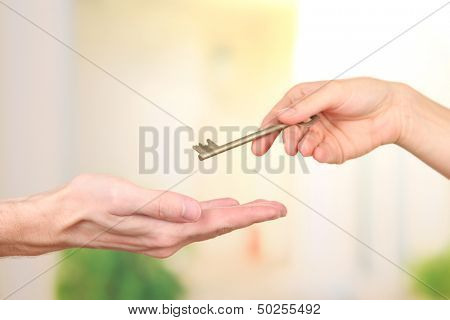 Transfer of house key, on bright background
