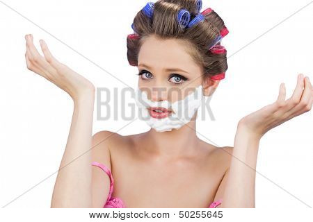 Questioning woman with shaving foam on face on white background