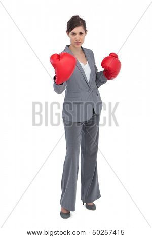 Competitive woman with red boxing gloves on white background