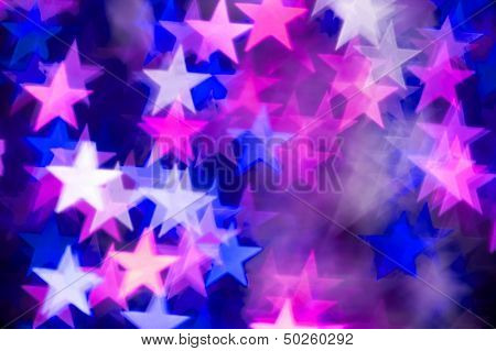 pink and blue stars bokeh as background