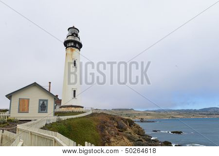 The Pigeon Point Lighthouse in a foggy day located on Pigeon Point Light Station State Historic Park, California