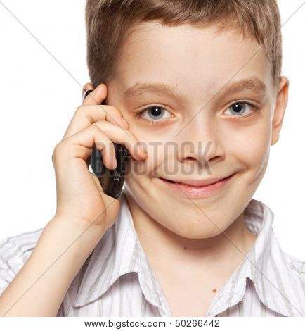 Boyl, speaking on the phone. Child talking on mobile phone