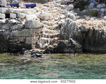Steep stone steps leading to the residential area under sea level .