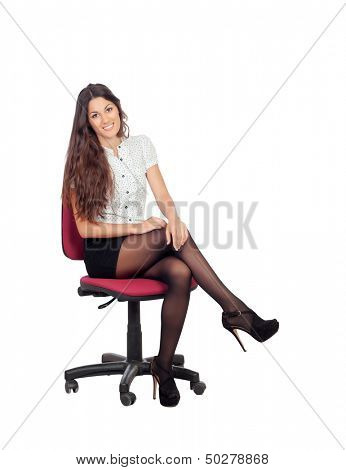 Pretty businesswoman in a stylish miniskirt sitting isolated on white
